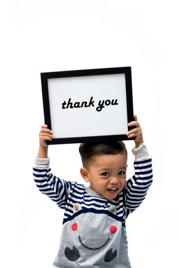 Males  Child One Boy Only Children Only One Person Boys Holding White Background Communication Blackboard  Front View Thank You Text Human Hand Kid EyeEmbestshots Showing