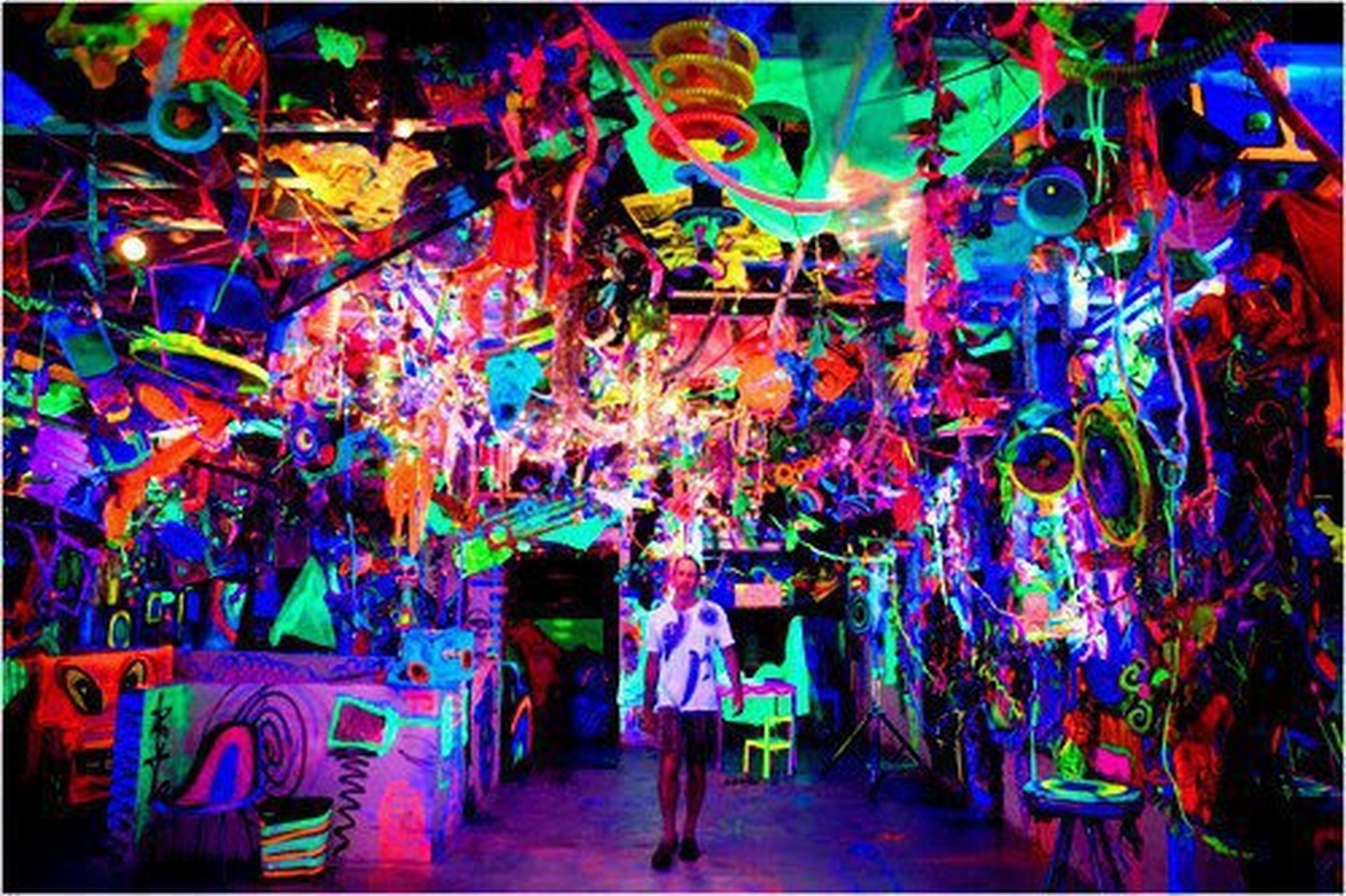 indoors, multi colored, art, illuminated, art and craft, creativity, cultures, celebration, night, tradition, leisure activity, lifestyles, arts culture and entertainment, men, decoration, person, hanging, religion, human representation
