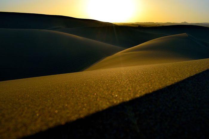 Beauty In Nature Day Desert Horizon Horizon Over Land Landscape Mountain Mountain Range Nature No People Outdoors Sand Dune Scenics Sky Sunlight Sunset Tranquil Scene
