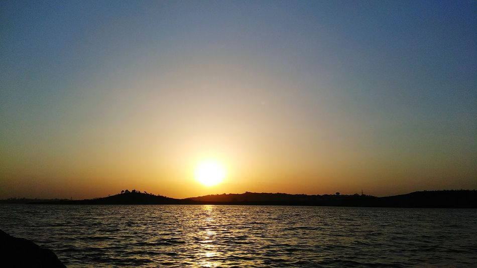 A darling dusk of heavenly body.. Dusky Sun Dusky Evening Dusky Waters Sunsetphotographs Sunset Lovers Scenics Landscape Tranquility Reflection Clear Blue Sky Sunlight Water Sunset Beauty In Nature Travel Destinations Lakes And Mountains Lakescape Landscape_Collection