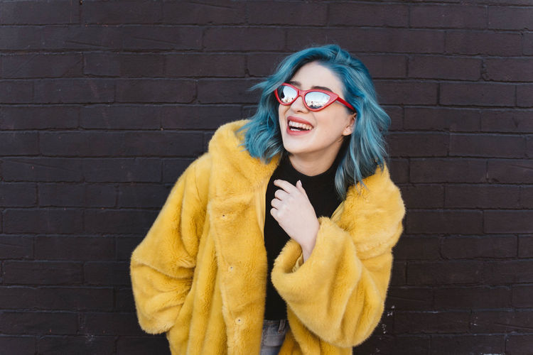 Waist Up Portrait Beautiful Woman Beauty Coat Adult Smiling Happiness Winter Glasses Clothing Young Adult Front View Yellow Cold Temperature One Person Warm Clothing Women Fashion Brick Hairstyle