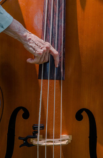 Cropped hand playing cello