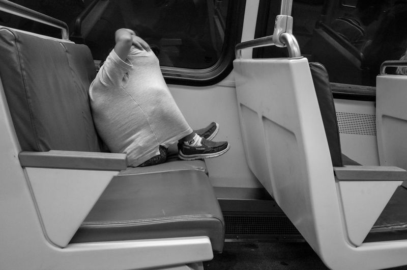 I think we all feel this way sometimes... EyeEmNewHere Ricoh Gr Subway Street Photography Streetphoto_bw Streetphotography Hiding Secure Blackandwhite Transportation Mode Of Transport Real People Public Transportation Land Vehicle One Person Sitting People Indoors