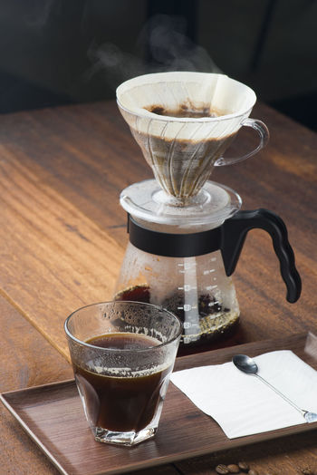 coffe dripping Close-up Coffee Coffee - Drink Coffee Cup Coffee Maker Coffee Pot Crockery Cup Drink Drip Coffee Focus On Foreground Food And Drink Freshness Glass Household Equipment Indoors  Mug No People Refreshment Still Life Table Transparent Tray Wood - Material