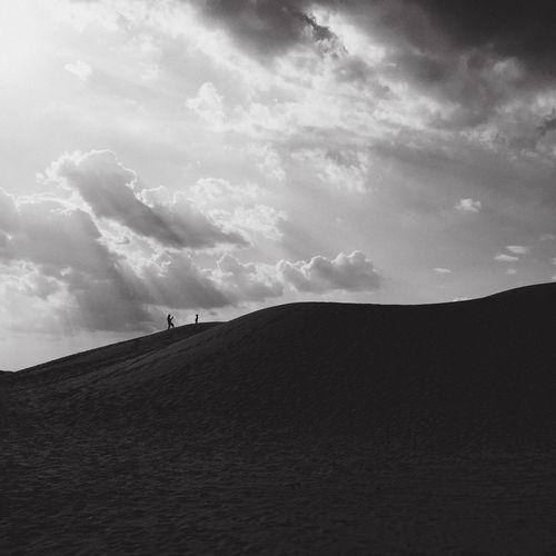 Silhouette of sand dunes in desert