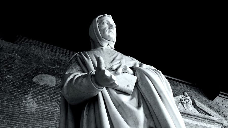 Low angle view of statue at camposanto cemetery at night