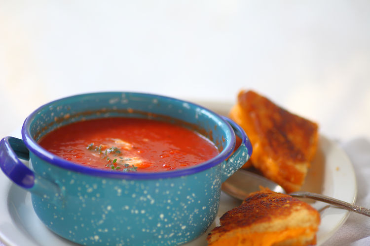 Tomato soup, grilled cheese and copy space American Food Blue Close-up Comfort Food Copy Space Day Dinner Fresh Herbs  Freshness Grilled Cheese Home Cooking Home Food Indoors  Light Supper Lunch No People Plate Ready-to-eat Red Snack Toasted Bread Tomato Soup White