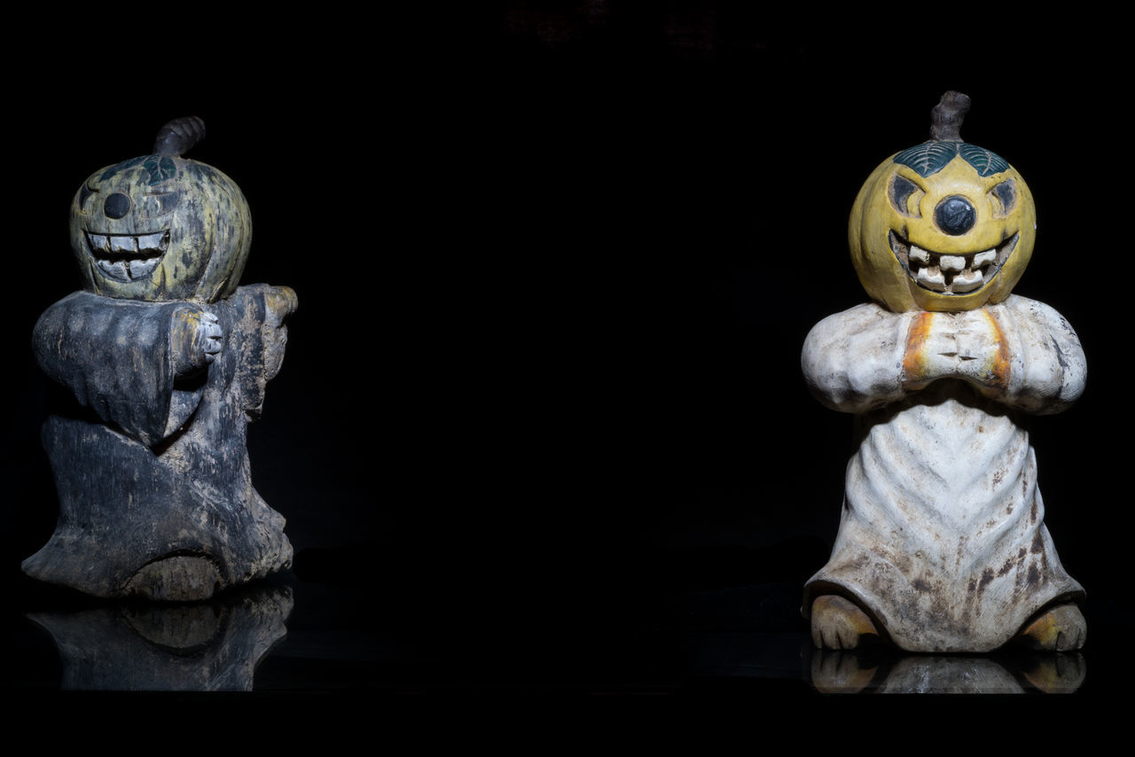 human representation, statue, art and craft, male likeness, sculpture, no people, indoors, close-up, black background, day