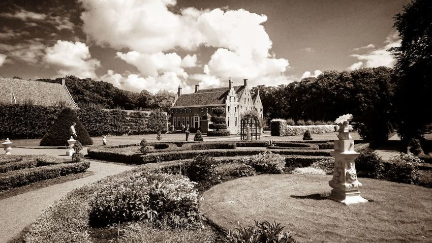 Castle an Garden in Monochrome Sepia . Enjoying The View of a Monumental Building . Visiting Museum in Uithuizen