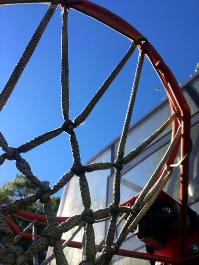 Basketball hoop and Carolina blue sky Blue Metal Basketballhoop Carolinabluesky