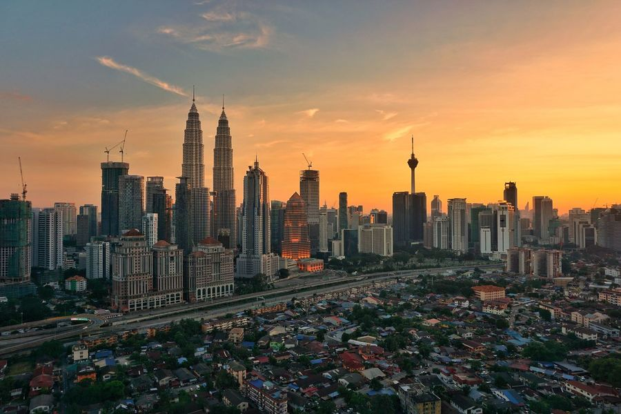 Kuala Lumpur Sunset skyline Sunset Skyline Skyscraper Architecture Urban Skyline Cityscape Building Exterior Downtown District Sunset City Business Finance And Industry Office Building Exterior Modern Travel Destinations Sky Built Structure Outdoors