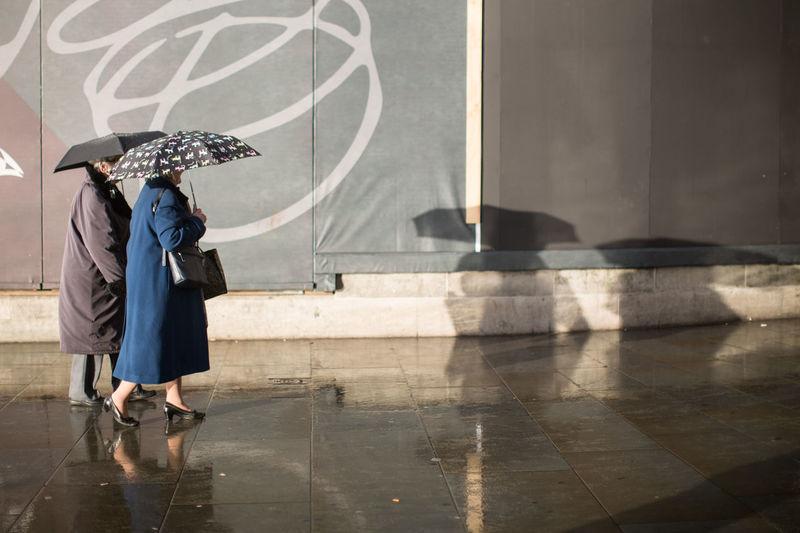 Ladies Old Ladies Pavement Rain Shadow Shadows Street Street Photography Umbrellas Walking Weather Wet Postcode Postcards Postcode Postcards The Photojournalist - 2018 EyeEm Awards