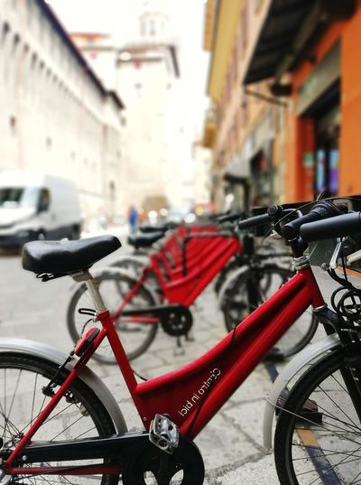 BOLOGNA , ITALY - MAY 28, 2018 : Street view of Bologna red public bicycles. Transportation Public Transportation Bicycle Trip Raw Street Traveling Travel Destinations Europe Trip Europe European  Ride A Bike  Rent A Bike RENT City Life City Red Bicycle Land Vehicle Cityscape City Life Street Stationary Defocused Architecture Bicycle Rack Parking Urban Road City Street Cycling Locked