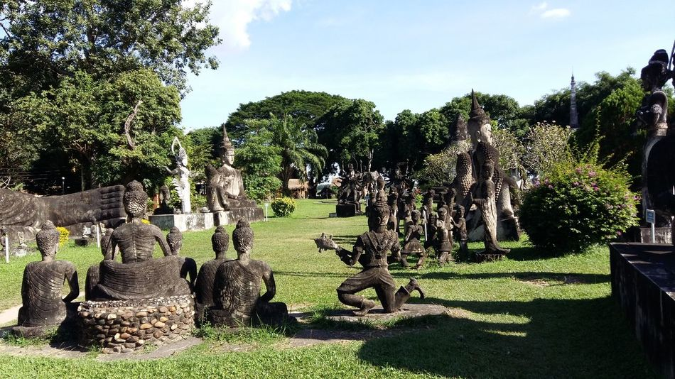 Tree Sunlight Green Color Outdoors Leisure Activity Johnnelson Lifeasiseeit John Nelson Vientiane Landscape No People Architecture Statuesque Buddha Statue BuddhaPark Laos