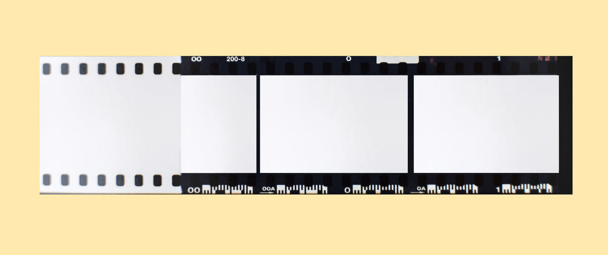 (35 mm.) film frame.With white space. Copy Space Camera Film Technology No People Yellow White Color Frame Blank Film Industry Wall - Building Feature Black Color Indoors  Paper Side By Side Arts Culture And Entertainment Studio Shot Film Reel Picture Frame Creativity Digital Composite Film Film Photography