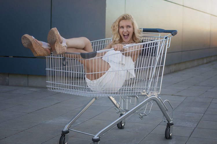 Shopping is my insanity Fashion Stories Adult Blond Hair Consumerism Day Full Length Happiness Indoors  Looking At Camera One Person People Portrait Shopping Cart Smiling Young Adult Young Women