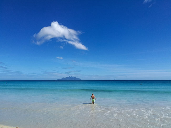 Sea Beach Full Length Blue Sand Horizon Over Water People Sky One Person Nature Clear Sky Travel Destinations Adult Outdoors Beauty In Nature Water Day Vacations Tranquility Only Men Tropical Climate Travel Aesthetic Island Berjaya Beach Seychelles