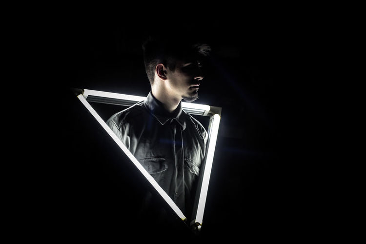 Triangle Shape Man Light And Shadow Light EyeEm Ready   Black Background Horror One Person Adult Studio Shot Halloween Evil People Night Indoors  Young Adult Fresh On Market 2018