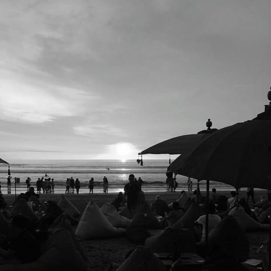 Monochrome Photography Sunset Sea Outdoors Large Group Of People Nature Beach Vacations Water Horizontal Tranquility People Travel Destinations Leisure Activity Adult Summer Group Of People Beauty In Nature Person Scenics Sky