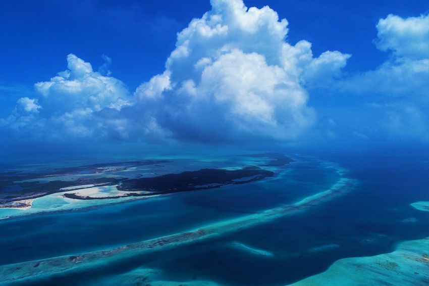Aerial view of island and beach in Los Roques, Venezuela Cloud - Sky Sky Blue Scenics - Nature Water Nature Sea No People Cloudscape Beauty In Nature Tropical Climate Environment Tranquil Scene Tranquility Land Landscape Island Travel Destinations Beach Outdoors Horizon Over Water Turquoise Colored Lagoon Los Roques Madrisqui Caribe Caribbean Caribbean Life Caribbean Island Francisqui Crasqui Carenero's Beach Cayo De Agua Venezuela
