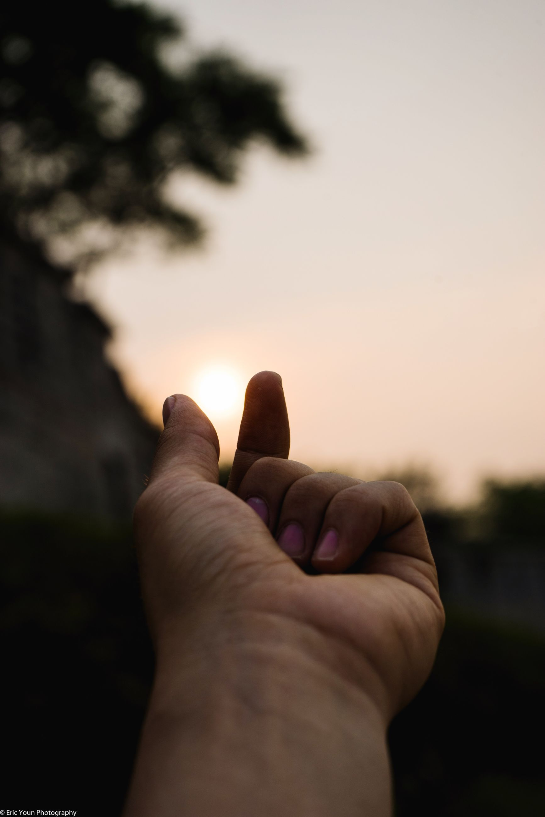 person, personal perspective, part of, human finger, cropped, unrecognizable person, holding, close-up, focus on foreground, lifestyles, leisure activity, copy space, sunset, men, selective focus, showing, nature