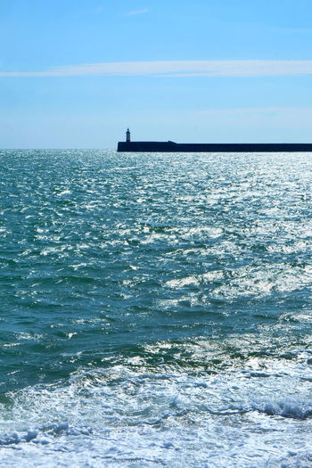Light House Newhaven East Sussex Shimmering Sea Silhouette Beauty In Nature Blue Day Harbour Wall Horizon Horizon Over Water Idyllic Light House And Blue Sky Motion Nature No People Outdoors Rippled Safe Safety Sea Sky Tranquil Scene Tranquility Waterfront Wave