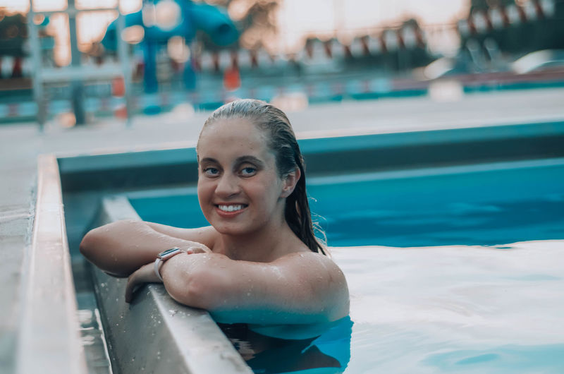 Portrait of smiling young woman in swimming pool