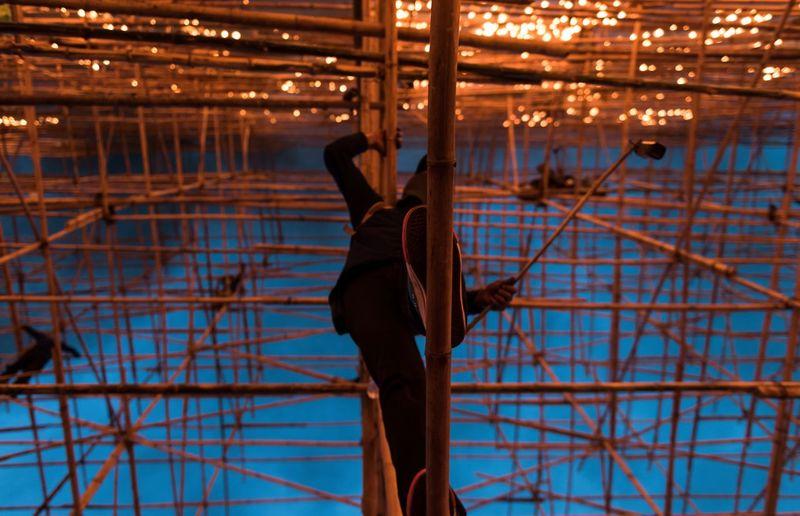 Directly below shot of man on scaffolding
