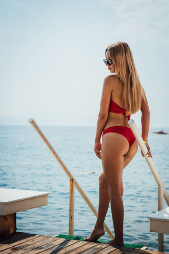Water Hair Young Adult Blond Hair Sea One Person Young Women Clothing Swimwear Leisure Activity Real People Sky Hairstyle Beauty Full Length Women Fashion Bikini Beautiful Woman Horizon Over Water Outdoors