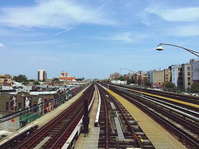 Transportation Sky Railroad Track Public Transportation Rail Transportation Architecture Cloud - Sky Mode Of Transport Built Structure Day The Way Forward Outdoors Building Exterior City No People Tracks Brooklyn Coney Island Metro Subway Rails Suburbs New York Outskirts Harlem
