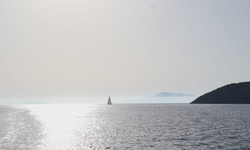 arrivée sur Amorgos Getty Images The Traveler - 2018 EyeEm Awards Sailing Ship Beauty In Nature Clear Sky Copy Space Crepuscular Light Day Horizon Horizon Over Water Idyllic Nature Nautical Vessel No People Non-urban Scene Outdoors Sailing Scenics - Nature Sea Sky Tranquil Scene Tranquility Water Waterfront EyeEmNewHere The Great Outdoors - 2018 EyeEm Awards Capture Tomorrow