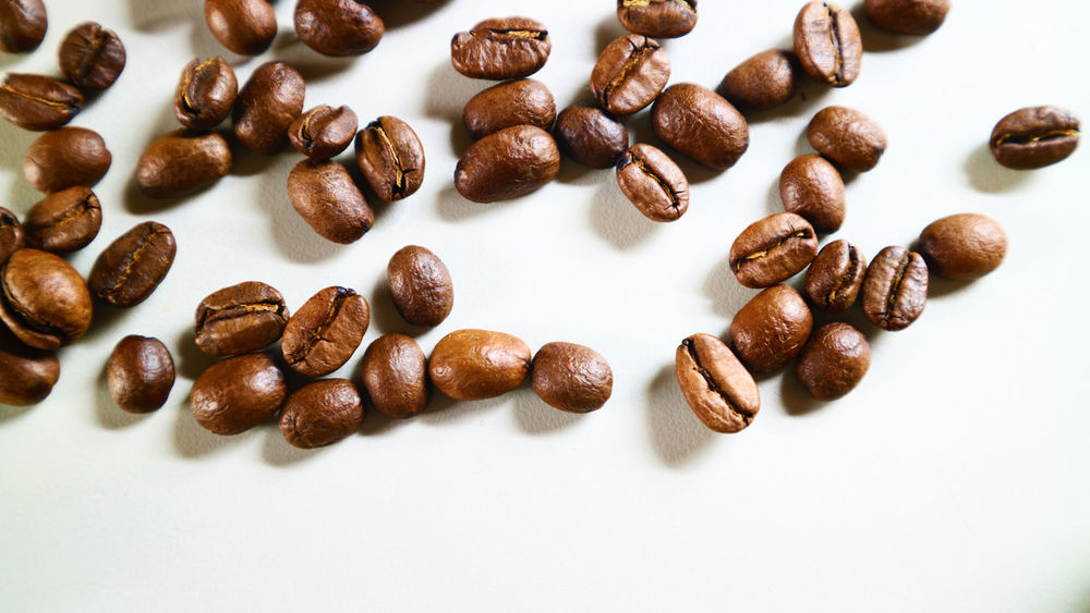 The Coffee Bean Brown Close-up Coffee - Drink Coffee Bean Food Food And Drink Freshness Indoors  No People Raw Coffee Bean Roasted Coffee Bean Scented Still Life White Background