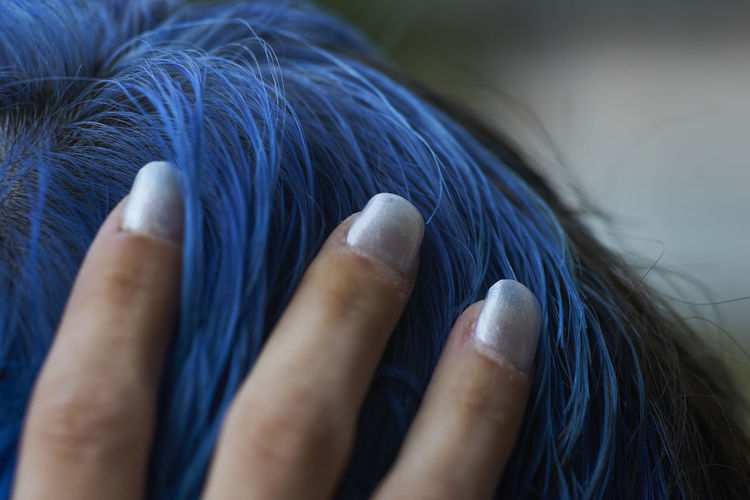 Close-up of woman hand with blue eyes
