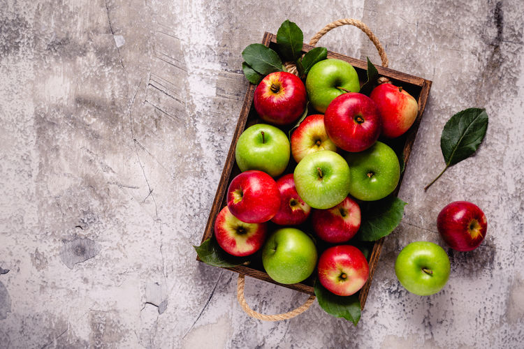 Directly above shot of apples in container on table