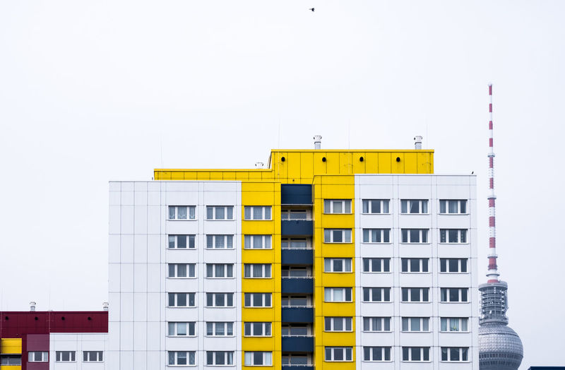 Sky Clear Sky Architecture Building Exterior No People Built Structure City Outdoors Building Yellow Copy Space Day In A Row Residential District Side By Side Fernsehturm Berlin