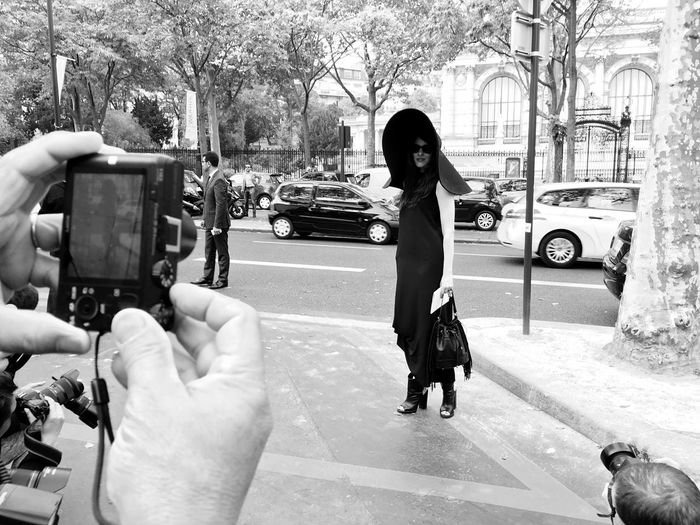 A Fashionista poses for Photographers outside Palais De Tokyo at Paris Fashion Week SS16 Big Hat shot on IPhone 6s