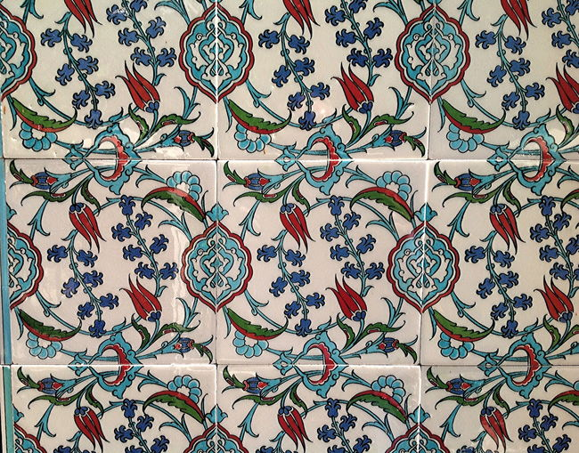 Closeup of historic tiles in a Curaçao Landhuis Arts Culture And Entertainment Backgrounds Curaçao Landhuis Tiles Day Historic Tiles Multi Colored No People Tiles Wall Decoration