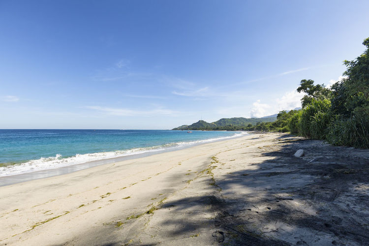 Completely empty beach in Paga, East Nusa Tenggara, Indonesia. Holiday INDONESIA Nature Rural Tourist Travel Attraction Beach Boat Deserted Destination East Nusa Tenggara Fishing Flores Landscape Ocean Paga Sea Sikka Regency Swim Tourism Tropical Vacation Village White Sand