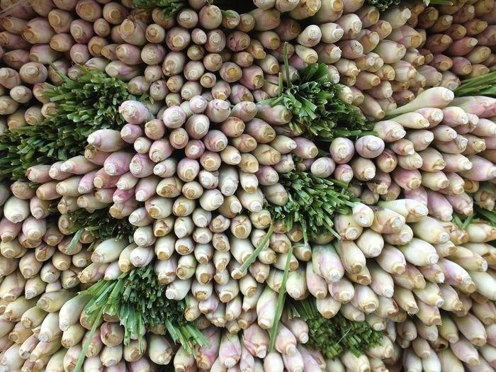 Full frame shot of scallions for sale at market stall
