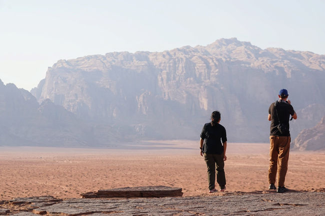 Desert Deserts Around The World Rock Wadi Rum Adventure Arid Climate Beauty In Nature Day Dune Full Length Hiking Landscape Marsions Mountain Mountain Range Nature Outdoors Real People Rock - Object Rogue One Scenics Sky Standing Togetherness