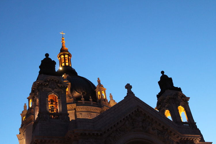 Low angle view of church against blue sky