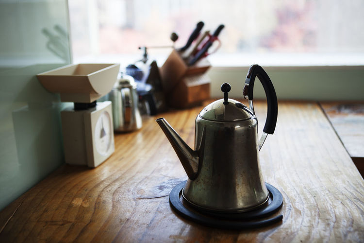 Metallic teapot at kitchen counter