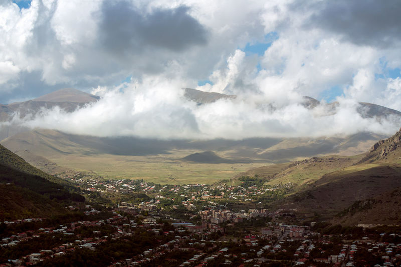 A mountain top view of Goris city, Armenia. Armenia High Up Above Aerial View Air Vehicle Airplane Architecture Beauty In Nature Building Exterior Built Structure City Cityscape Cloud - Sky Day Environment Flying Landscape Mountain Nature No People Outdoors Scenics - Nature Sky