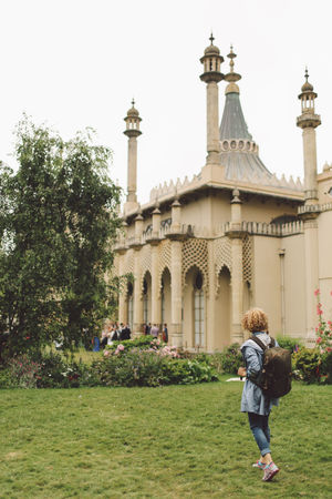 Arch Architecture Backpack Blonde Brighton Built Structure Casual Clothing Curly Hair Day Dome Façade Famous Place Full Length Girl Grass Lawn Leisure Activity Lifestyles Royal Pavilion Royal Pavilion Gardens Tourism Tourist Travel Destinations Tree Vacations Connected By Travel An Eye For Travel