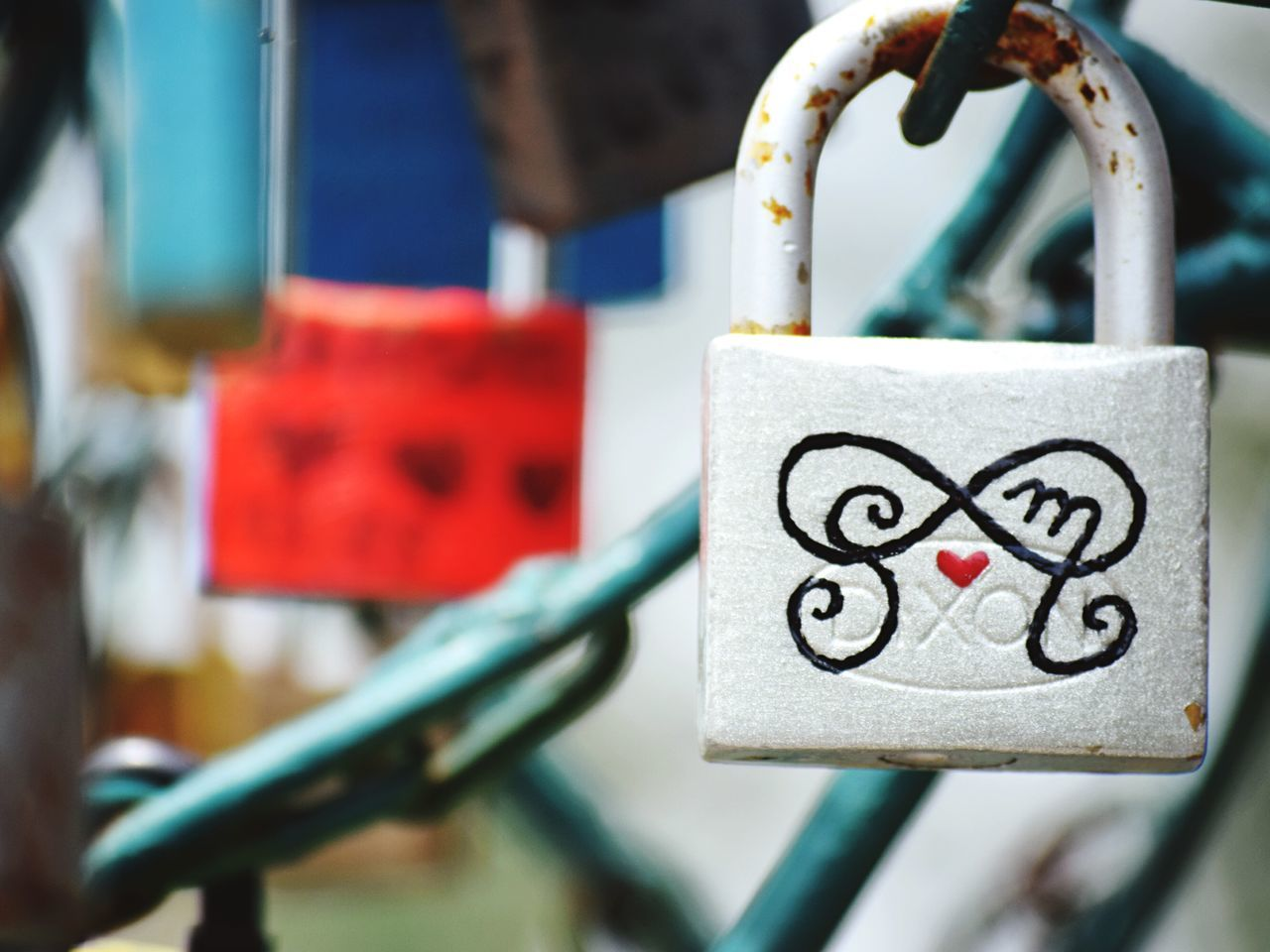 Close-Up Of Padlock Against Blurred Background