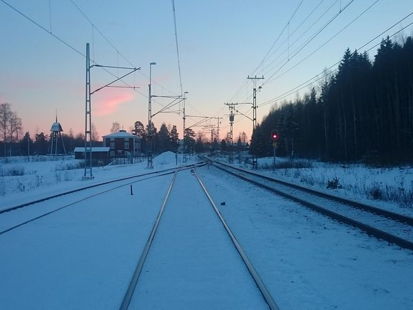 Railway Electric Train Ecofriendly Railroad Train Tracks Tracks Winter Landscape Power Lines Cold Temperature Winter Snow Norrland Sweden Track Sunset Evening Evening Sky Chapel Clock Tower Infrastructure Tracks In The Snow CarbonNeutral Transportation
