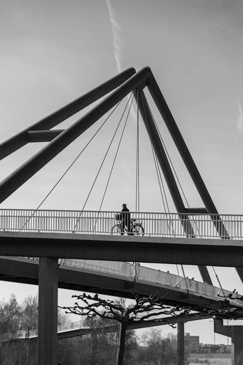 Düsseldorf, Germany Brücke Deutschland Düsseldorf NRW Architecture Bnw Bridge Bridge - Man Made Structure Built Structure Connection Day Engineering Outdoors Radfahrer Real People Schwarzweiß Sky Transportation