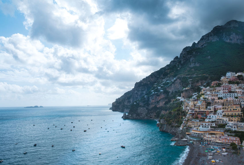 Amalfi Coast Beach Beauty In Nature Cityscape Cliff Cloud - Sky Coastline Crowded Day Famous Place Horizon Over Water Mediterranean Culture Mediterranean Sea Mountain Nature No People Outdoors Scenics Sea Seascape Sky Tranquility Water