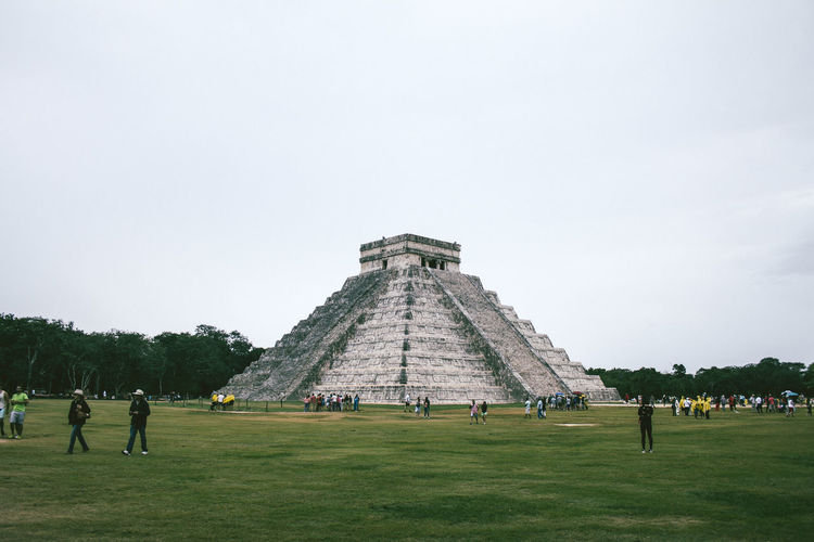 People At Historic Chichen Itza Against Sky