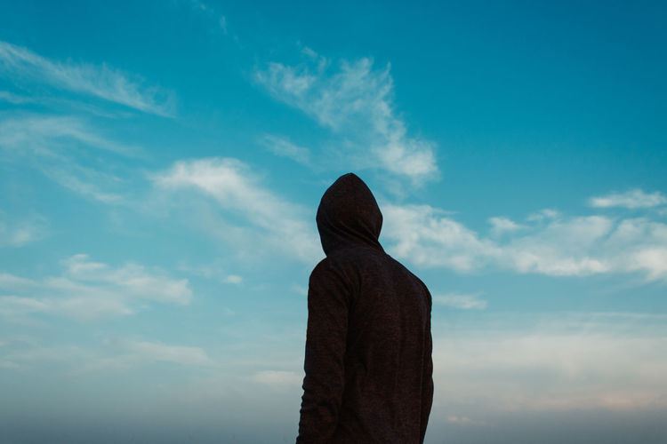 Cloud - Sky Sky Rear View One Person Day Nature Real People Lifestyles Low Angle View Hood Standing Unrecognizable Person Leisure Activity Clothing Outdoors Sculpture Waist Up Beauty In Nature Blue Hood - Clothing The Minimalist - 2019 EyeEm Awards The Great Outdoors - 2019 EyeEm Awards The Traveler - 2019 EyeEm Awards